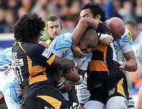 High Wycombe, England. Aleki Lutui of Worcester Warriors  tackled during the Aviva Premiership match between London Wasps and Worcester Warriors at Adam Park on October 7, 2012 in High Wycombe, England.