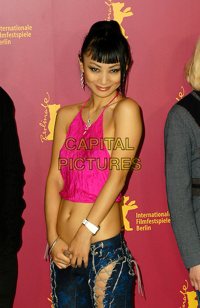 BAI LING.55th Berlin International Film Festival.February 10th, 2005.half length pink halterneck top belly stomach midriff watch.www.capitalpictures.com.sales@capitalpictures.com.©Capital Pictures