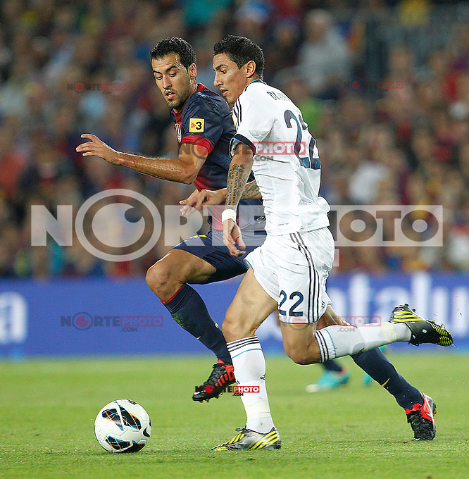 Barcelona's Sergio Busquets and Real Madrid's Angel di Maria during la Liga match on october 7th 2012. ..Photo: Cesar Cebola  / ALFAQUI /©NortePhoto