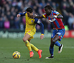 Crystal Palace's Pape Souare tussles with Arsenal's Alexis Sanchez<br /> <br /> Barclays Premier League - Crystal Palace  vs Arsenal  - Selhurst Park - England - 21st February 2015 - Picture David Klein/Sportimage