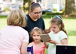 TORRINGTON, CT-081017JS02--Felicia Benevides of Torrington, along with her children Faith Todd, 7, and Kristine Todd, 10,  talk with Judith Theeb, principal at Southwest School in Torrington, during a back to school gathering Thursday at Coe Park in Torrington.  All three of Benevides' children, including Richard Todd, Jr., 8,  will be attending Southwest when the school year begins. <br /> Jim Shannon Republican-American