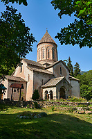 "Pictures & imagse of Timotesubani medieval Orthodox monastery Church of the Holy Dormition (Assumption), dedcated to the Virgin Mary, 1184-1213, Samtskhe-Javakheti region, Georgia (country).<br /> <br /> Built during the reigh of Queen Tamar during the ""Golden Age of Georgia"", Timotesubani Church of the Holy Dormition is one of the most important examples of medieval Georgian architecture and art. <br /> <br /> Built of pinkish Georgian brick to a cruciform floor plan. The eastern end of the church has 3 apses. Above the centre of the church is a high Georgian style cupola supported on 2 columns."