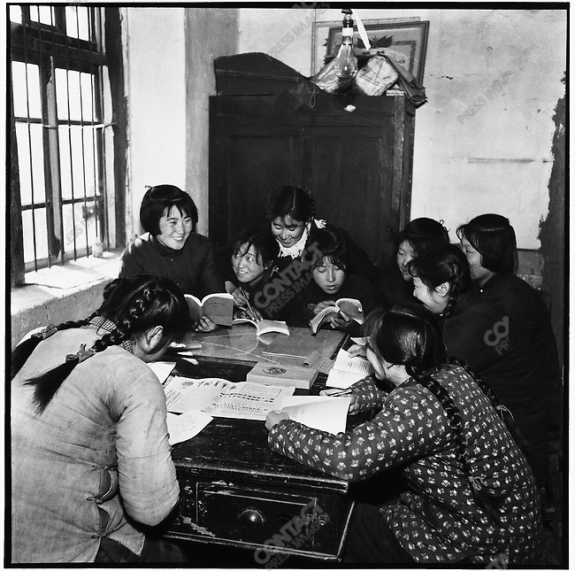 "After work, they spend hours studying Mao's works and reading Party-controlled newspapers such as the China Youth Daily, including this one with the headline ""Vietnamese troops shoot down twelve American planes for a total of over one hundred in seven months.""  Ashihe commune, Acheng county, 18 April, 1965"