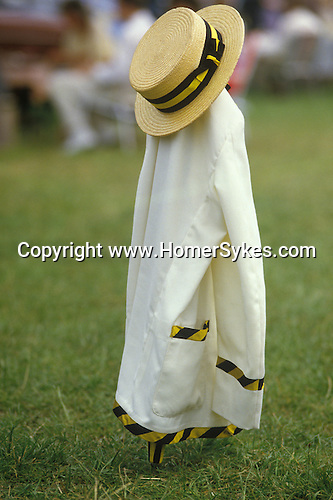 Straw boater and rowing club blazer hanging on a rolled umbrella. Henley Regatta. Henley on Thames Oxfordshire.  The English Season published by Pavilon Books 1987