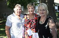 NWA Democrat-Gazette/CARIN SCHOPPMEYER Lou Jasper (from left), Lona Mullins and Carol Harris volunteer at Drink the Garden.