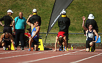 Otago's Chris Donaldson (second left) and Auckland's Jeffrey Thumath (right) signal the track referee as David Ambler (second right) prepares to race after a false start in the men's 100m final. The eventual winner was Auckland's Chris Van Der Speck (right). National athletics championships at Newtown Park, Wellington, New Zealand on Friday, 27 March 2009. Photo: Dave Lintott / lintottphoto.co.nz