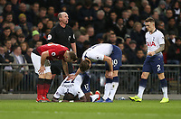 Tottenham Hotspur's Moussa Sissoko falls to the ground with an injury<br /> <br /> Photographer Rob Newell/CameraSport<br /> <br /> The Premier League - Tottenham Hotspur v Manchester United - Sunday 13th January 2019 - Wembley Stadium - London<br /> <br /> World Copyright &copy; 2019 CameraSport. All rights reserved. 43 Linden Ave. Countesthorpe. Leicester. England. LE8 5PG - Tel: +44 (0) 116 277 4147 - admin@camerasport.com - www.camerasport.com
