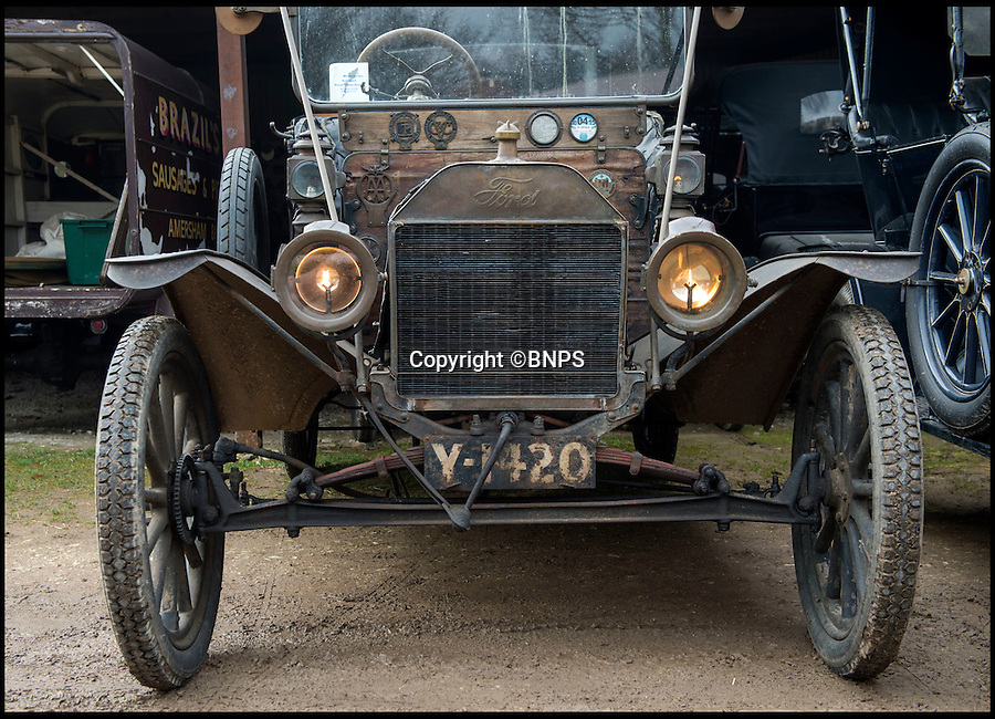 BNPS.co.uk (01202 558833)<br /> Pic: PhilYeomans/BNPS<br /> <br /> Gas powered headlights...if you've got a match.<br /> <br /> Garage that time forgot...<br /> <br /> Business is booming at Neil Tuckets time warp garage in the heart of Buckinghamshire - Where you can by any car…as long as its a Model T Ford.<br /> <br /> Despite his newest models being nearly 90 years old, Neil struggles to keep up with demand with customers snapping up one a week, despite their rudimentary levels of comfort and trim.<br /> <br /> Neil sources his spares from all over the globe and carefully puts the machines back together again.<br /> <br /> 'There like a giant meccano set really, and so beautifully simple and reliable they just won't let you down...You also don't require road tax or and MOT!'