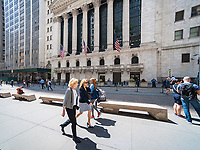 Tourists and workers outside the New York Stock Exchange on Tuesday, May 2, 2017. (© Richard B. Levine)