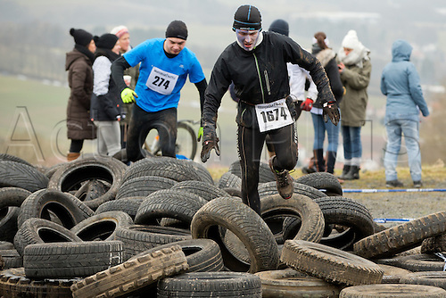 12.03.2016. Bischofsheim, Germany.  Participants of the extreme run Braveheart Battle climbing an obstacle in Bischofsheim, Germany. Almost 2,700 runners have to manage a 30 kilometer track with 45 obstacles. The extreme run event leads through ice cold water, deep mud pits and hot fire obstacles. It is said to be one of the hardest in Europe.