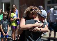 Renee Brock hugs her son Griffin at the crash site where Heather Heyer died exactly one week ago after a car plowed through a group of people on 4th Street SE. Photo/Andrew Shurtleff
