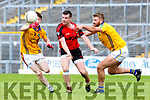 Sean O'Leary Kenmare Shamrocks gets his pass away fro Damien Somers and Aaron O'Connor Feale Rangers during the SFC clash in Fitzgerald Stadium on Sunday