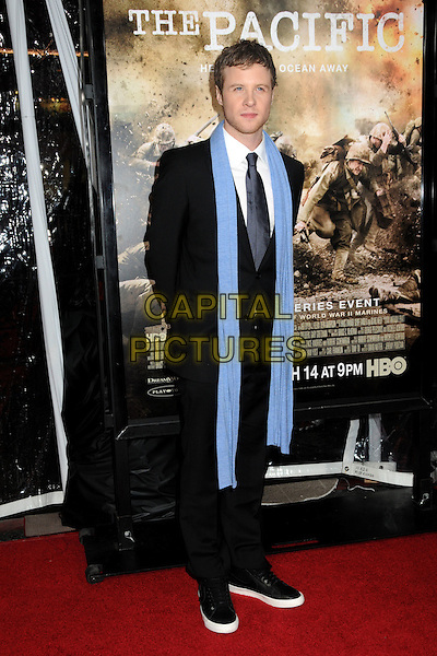 "ASHTON HOLMES.HBO's ""The Pacific"" Mini-Series Premiere held at Grauman's Chinese Theatre, Hollywood, California, USA..February 24th, 2010.full length suit black blue scarf white.CAP/ADM/BP.©Byron Purvis/AdMedia/Capital Pictures."