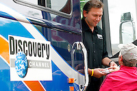 Johan Bruyneel, directeur sportif of the Discovery Channel Pro Cycling Team, speaks to a fan from the team bus before Stage 2 of the 2006 Ford Tour de Georgia.<br />