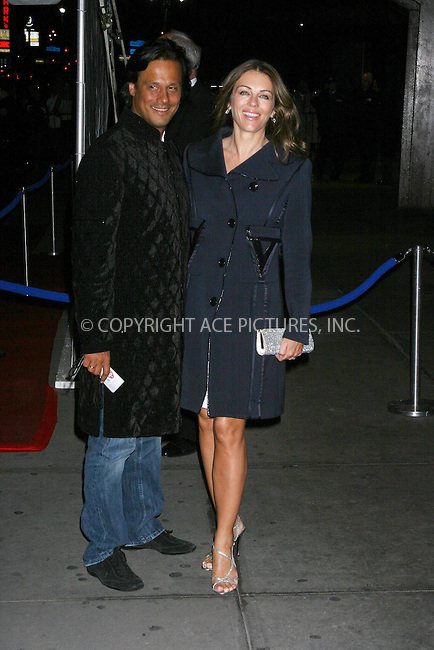 WWW.ACEPIXS.COM . . . . .  ....March 25 2007, New York City....Indian businessman Arun Nayar (L) and his new wife actress Elizabeth Hurley attending Elton John's 60th Birthday Concert at Madison Square Garden ......Please byline: JOHN WARD - ACEPIXS.COM.... *** ***..Ace Pictures, Inc:  ..Philip Vaughan  (646) 769 0430..e-mail: info@acepixs.com..web: http://www.acepixs.com