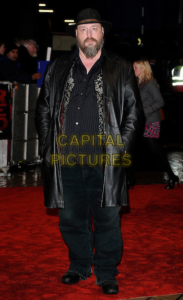 WARREN ELLIS.Attending the UK Film Premiere of 'Red' at the Royal Festival Hall, London, England, UK..October 19th 2010.full length hat black leather coat shirt jeans denim hand sin pocket beard facial hair.CAP/CAN.©Can Nguyen/Capital Pictures.