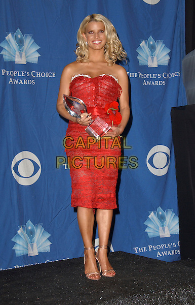 JESSICA SIMPSON.The 32nd Annual People's Choice Awards held at The Shrine Auditorium in Los Angeles, California .January 10th, 2006.Ref: DVS.full length strapless red dress award trophy.www.capitalpictures.com.sales@capitalpictures.com.Supplied By Capital PIctures