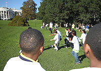 "Kids play in front of the White House during a  D.C United clinic in support of first lady Michelle Obama's ""Let's Move"" initiative on the White House lawn, in Washington D.C. on October 7 2010."
