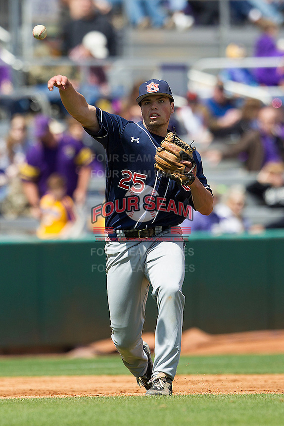 Auburn Tigers third baseman Damek Tomscha #25 makes a throw to first base against the LSU Tigers in the NCAA baseball game on March 24, 2013 at Alex Box Stadium in Baton Rouge, Louisiana. LSU defeated Auburn 5-1. (Andrew Woolley/Four Seam Images).