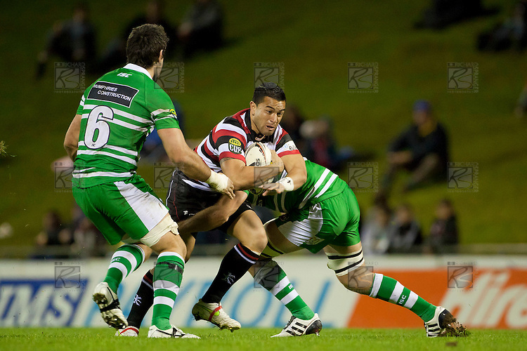 Sherwin Stowers goes for the gap between Nick Crosswell and Michael Fitzgerald.  ITM Cup Championship Division Round 2 rugby game between Counties Manukau Steelers and Manawatu, played at Bayer Growers Stadium Pukekohe, on Wednesday July 20th 2011. Counties Manukau won the game 32 - 25 after leading 19 - 18 at halftime.