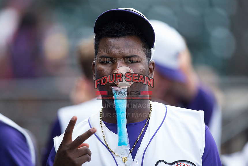 Winston-Salem Dash pitcher Victor Diaz (18) enjoys an ice pop on a hot August day during the game against the Potomac Nationals at BB&T Ballpark on August 6, 2017 in Winston-Salem, North Carolina.  The Nationals defeated the Dash 4-3 in 10 innings.  (Brian Westerholt/Four Seam Images)
