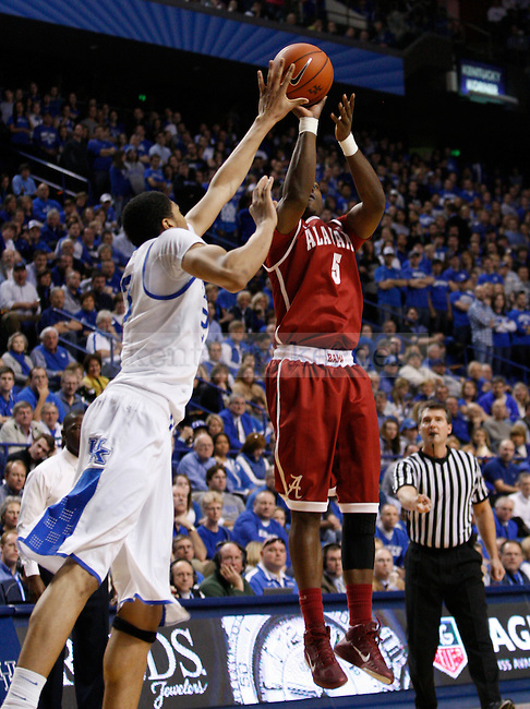 UK forward Anthony Davis attempts to block a shot from Alabama forward Tony Mitchell during the second half of the UK Men's basketball game against Alabama on 1/21/12 in Lexington, Ky. Photo by Quianna Lige | Staff