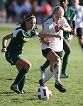 Katie Dry fights for the ball with Manogue's Mary Glenn in the 4-1 Douglas victory Tuesday, Sept. 20, 2011, in Gardnerville, Nev..Photo by Cathleen Allison