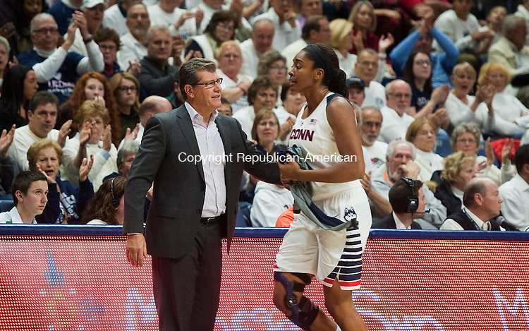 STORRS, CT--- -12015JS13--UConn head coach Geno Auriemma welcomes Morgan Tuck as she heads to the bench during their game  against Notre Dame Saturday at Gampel Pavilion in Storrs. <br /> Jim Shannon Republican-American
