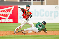 Greensboro Grasshoppers second baseman Blake Barber (8) attempts to turn a double play as Andrew Cain (36) of the Augusta GreenJackets slide into second base at NewBridge Bank Park on August 11, 2013 in Greensboro, North Carolina.  The GreenJackets defeated the Grasshoppers 6-5 in game one of a double-header.  (Brian Westerholt/Four Seam Images)