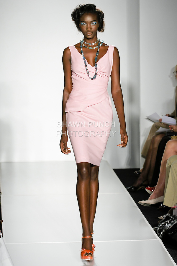 Model walks the runway in an outfit by Douglas Hannant for the Douglas Hannant Spring Summer 2011 Que Sera Sera! Collection, during New York Fashion Week, September 15, 2010.