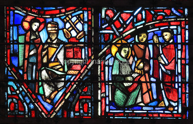 Fulbert meets the Pope (left) with the crossed keys indicating the successor of St Peter, and Fulbert studying in Reims (right) with an open book and 2 masters, from the Life of Fulbert stained glass window, in the south transept of Chartres Cathedral, Eure-et-Loir, France. This window replaces the original 13th century window depicting the Life of St Blaise, which was destroyed in 1791. It was created in 1954 by Francois Lorin as a gift of the Institute of American Architects, on a theme chosen by the Canon Yves Delaporte. It depicts the life of Fulbert, bishop of Chartres in the 11th century. Chartres cathedral was built 1194-1250 and is a fine example of Gothic architecture. Most of its windows date from 1205-40 although a few earlier 12th century examples are also intact. It was declared a UNESCO World Heritage Site in 1979. Picture by Manuel Cohen