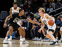 WASHINGTON, DC - JANUARY 28: Mac McClung #2 of Georgetown dribbles towards Henry Baddley #20 of Butler during a game between Butler and Georgetown at Capital One Arena on January 28, 2020 in Washington, DC.