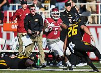 NWA Democrat-Gazette/CHARLIE KAIJO Arkansas Razorbacks wide receiver Brandon Martin (5) runs the ball in the first half during a football game on Friday, November 24, 2017 at Razorback Stadium in Fayetteville.