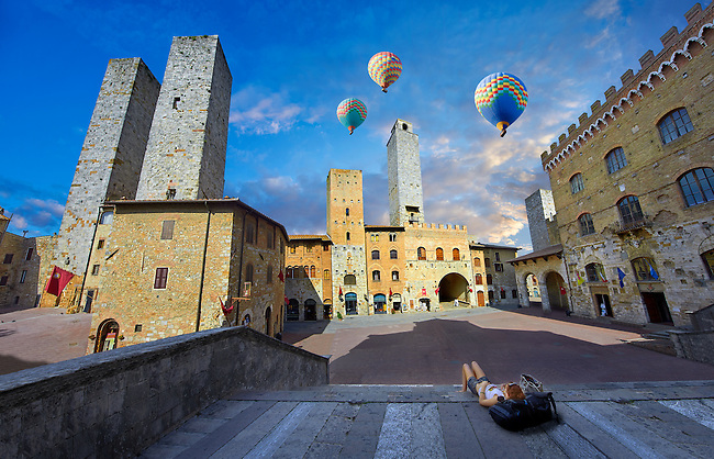 Hot Air Balloons over the Piazza Duomo (Cathedral Square) of San Gimignano with its medieval towers built as defensive towers and also to show the families wealth by the height of the tower. A UNESCO World Heritage Site. San Gimignano; Tuscany Italy