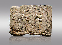 Picture &amp; image of Hittite monumental relief sculpted orthostat stone panel of a Procession Limestone, Karkamıs, (Kargamıs), Carchemish (Karkemish), 900-700 B.C. Anatolian Civilisations Museum, Ankara, Turkey.<br /> <br /> It is a depiction of three marching female figures in long dress with a high headdress at their head. These women are considered to be the nuns of the Goddess Kubaba. The figures in the front and behind have a round mirror in their right hand while the figure in the middle has a bunch of spica in her right hand. Figures carry objects similar to a sceptre in their left hand.  <br /> <br /> Against a gray background.