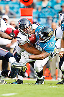 November 27, 2011:  Jacksonville Jaguars running back Maurice Jones-Drew (32) is tackled by Houston Texans tackle Derek Newton (75) for a loss during first half action between the Jacksonville Jaguars and the Houston Texans played at EverBank Field in Jacksonville, Florida.  ........