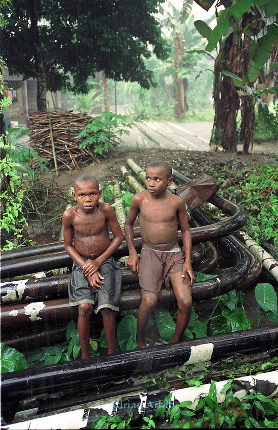 A Shell pipeline runs through the centre of an Ogoni village in Kenkana,  Ogoniland.   .The Ogoni  have been  complaing for years that the massive profits from oil extracted  from their  region  bring no  benefits to the local  community.