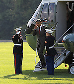 United States President Barack Obama salutes his Marine Guards as he arrives via Marine One to attend two campaign events at a private residence in McLean, Virginia on July 27, 2012. .Credit: Molly Riley / Pool via CNP