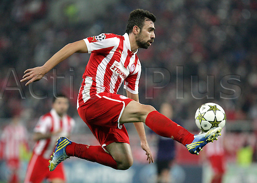 04.12.2012 Piraeus, Greece. Giannis Maniatis in action during the Champions League game between Olympiakos and Arsenal from the Karaiskaki Stadium