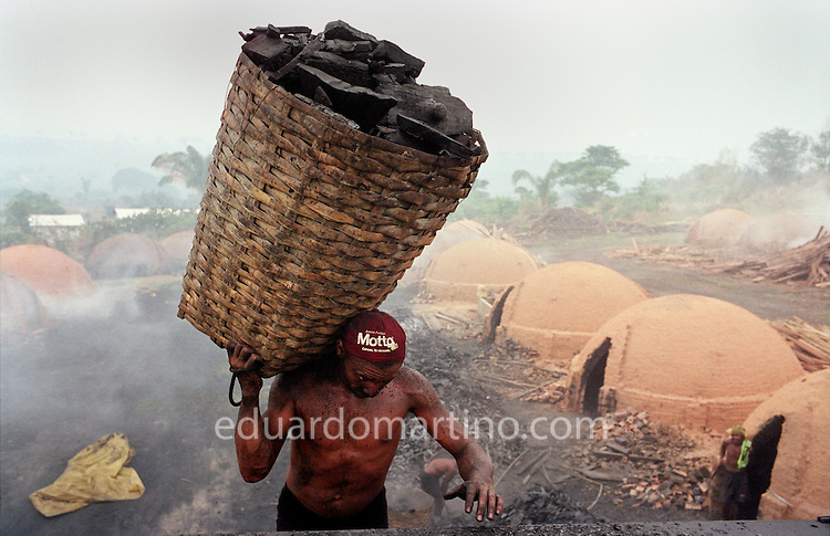 Modern-day slavery in Brazil A worker at a charcoal producing farm on the edge of the Amazon rainforest. The Ministry of Labour's grupo movel (mobile unit), who work to end the use of unfree labour in the region, are developing a pioneering activity to assign responsibility for the slavery cases reported on such farms to the pig iron producing companies, as the charcoal is made to be sold exclusively to these extremely profitable companies.<br />