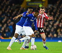 Lincoln City's Harry Toffolo vies for possession with Everton's Yerry Mina, left, and Everton's Ademola Lookman<br /> <br /> Photographer Andrew Vaughan/CameraSport<br /> <br /> Emirates FA Cup Third Round - Everton v Lincoln City - Saturday 5th January 2019 - Goodison Park - Liverpool<br />  <br /> World Copyright &copy; 2019 CameraSport. All rights reserved. 43 Linden Ave. Countesthorpe. Leicester. England. LE8 5PG - Tel: +44 (0) 116 277 4147 - admin@camerasport.com - www.camerasport.com