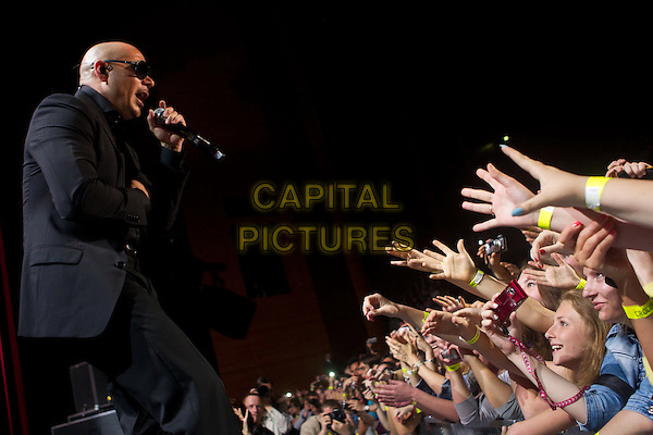 Pitbull (Armando Christian Perez).Concert in Krocus City Hall, Moscow, Russia..May 30th, 2012.on stage live gig performance performing music half length black suit sunglasses shades singing fans crowd audience profile .CAP/PER/SB.©SB/PersonaStars/CapitalPictures