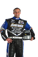 Jan. 8, 2012; Brownsburg, IN, USA; NHRA funny car driver Matt Hagan poses for a portrait during a photo shoot at the Don Schumacher Racing shop.  Mandatory Credit: Mark J. Rebilas-