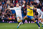 Sergio Ramos of Real Madrid (L) fights for the ball with Joaquin Navarro Jimenez, Ximo, of UD Las Palmas (R) during the La Liga 2017-18 match between Real Madrid and UD Las Palmas at Estadio Santiago Bernabeu on November 05 2017 in Madrid, Spain. Photo by Diego Gonzalez / Power Sport Images