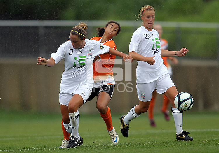 BOYDS, MARYLAND - July 21, 2012:  Rachel Baer (2) of Charlotte Lady Eagles is blocked by Elyse Tomasello (13) of the Long Island Roughriders during a W League Eastern Conference Championship semi final match at Maryland Soccerplex, in Boyds, Maryland on July 21.