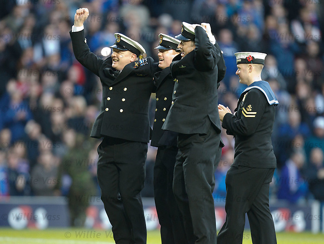 Members of the armed forces on the pitch at half-time doing the bouncy