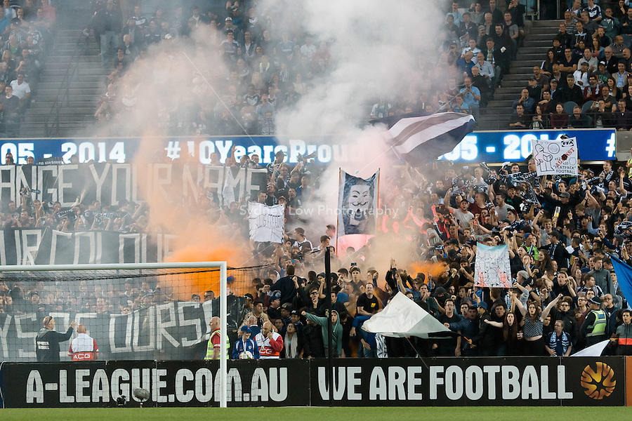 MELBOURNE 25 Oct 2014 – Melbourne Victory supporters let off flares in the round between Melbourne Victory and Melbourne City in the Australian Hyundai A-League 2014-15 season at Etihad Stadium, Melbourne, Australia.