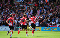 Lincoln City's John Akinde celebrates the opening goal from the penalty spot<br /> <br /> Photographer Andrew Vaughan/CameraSport<br /> <br /> The EFL Sky Bet League Two - Lincoln City v Swindon Town - Saturday August 11th 2018 - Sincil Bank - Lincoln<br /> <br /> World Copyright &copy; 2018 CameraSport. All rights reserved. 43 Linden Ave. Countesthorpe. Leicester. England. LE8 5PG - Tel: +44 (0) 116 277 4147 - admin@camerasport.com - www.camerasport.com