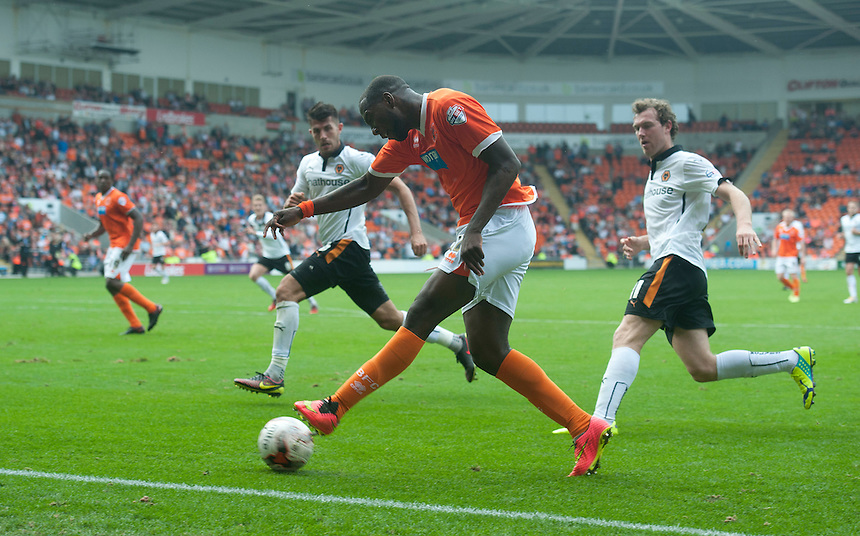 Blackpool's Ishmael Miller crosses despite the attentions of Wolverhampton Wanderers' Kevin McDonald<br /> <br /> Photographer Stephen White/CameraSport<br /> <br /> Football - The Football League Sky Bet Championship - Blackpool v Wolverhampton Wanderers - Saturday 13th September 2014 - Bloomfield Road - Blackpool<br /> <br /> &copy; CameraSport - 43 Linden Ave. Countesthorpe. Leicester. England. LE8 5PG - Tel: +44 (0) 116 277 4147 - admin@camerasport.com - www.camerasport.com