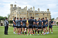 The Bath squad huddle together outside Farleigh House. Bath Rugby pre-season training session on August 18, 2014 at Farleigh House in Bath, England. Photo by: Patrick Khachfe/Onside Images